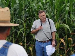 Dr. Peter Thomison standing in front of his corn research talking to a crowd