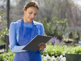 Women with clipboard standing in garden center