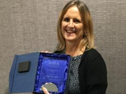 Peggy Hall with her award plaque