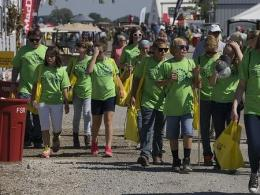 Photo of a group of people walking down a busy street at the Farm Science Review.