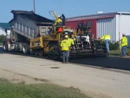 Photo of  blacktop being dumped from a hauling truck at the Farm Science Review.